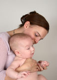 Mom and Baby. Smiling Mother and Baby on a white background royalty free stock photo