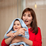 Mom and baby in a bathroom Stock Photo