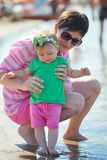 Mom and baby on beach  have fun Royalty Free Stock Photography
