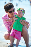 Mom and baby on beach  have fun Stock Photography