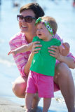 Mom and baby on beach  have fun Stock Images