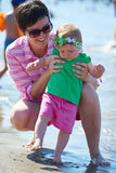 Mom and baby on beach  have fun Royalty Free Stock Photos