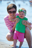 Mom and baby on beach  have fun Stock Photo