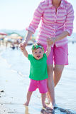 Mom and baby on beach  have fun Royalty Free Stock Photo