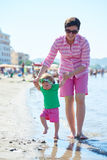 Mom and baby on beach  have fun Stock Image