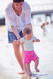 Mom and baby on beach  have fun Royalty Free Stock Image