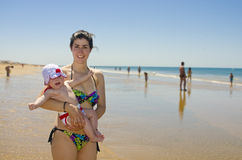Mom and baby in the beach Stock Images