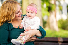 Mom and baby. Beauty mom and baby in nature Royalty Free Stock Photo