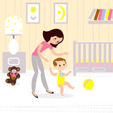 Mom and baby in the childrens room. The first seps of the child. Mom and child in the childrens room. The first seps of the baby Royalty Free Stock Photos