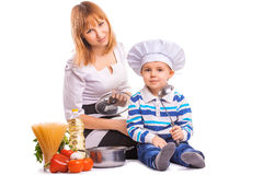 mom and baby are cooking   Stock Photo