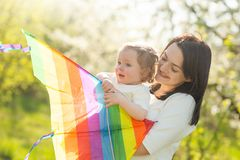 Mom with the baby and the darem air. With the sun beam, in the perk. Mother`s Day, care, March 8 stock image