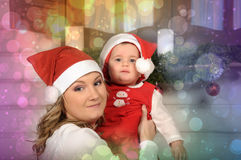 Mom and baby daughter in Christmas Stock Photo