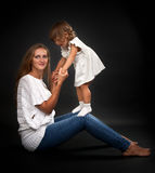 Mom and baby daughter in the studio Stock Photo