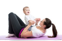 Mom with baby do gymnastics and fitness exercises Stock Photography