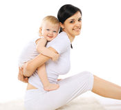 Mom and baby doing exercise. Portrait mom and baby doing exercise home, gymnastics, yoga, fitness and health - concept Royalty Free Stock Photography