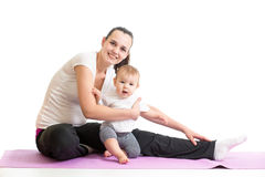 Mom with baby doing gymnastics Royalty Free Stock Photos