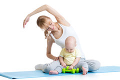 Mom with baby doing gymnastics and fitness Royalty Free Stock Photo