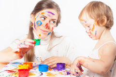 Mom and baby draws with colored inks Stock Photography