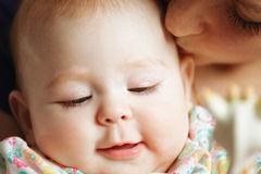 Mom and baby faces. Closeup Royalty Free Stock Image