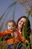 Mom and baby girl. Happy mom and daughter in the parc Royalty Free Stock Photography