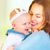 Mom and baby girl kissing and hugging at home Royalty Free Stock Images