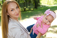 Mom and baby girl in park Royalty Free Stock Photo