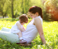 Mom and baby having fun on grass Royalty Free Stock Photography
