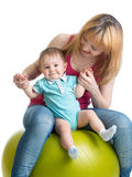 Mom and baby having fun on gymnastic ball Royalty Free Stock Photography