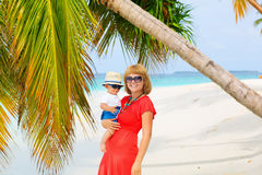 Mom and baby having tropical vacation Stock Photos
