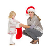 Mom with baby holding Christmas sock Stock Photo