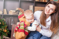 Mom with baby holding toy of big elk! Royalty Free Stock Images