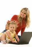 Mom and baby with laptop. Adorable baby girl toddler sitting on the floor with mom working on a laptop computer Stock Images