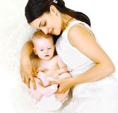 Mom and baby. Lying in the bed home Stock Image