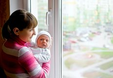 Mom with baby near window Royalty Free Stock Photo