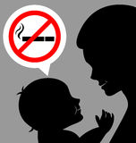 Mom and baby with a prohibiting smoking sign Royalty Free Stock Photography