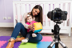 Mom and baby recording a video Royalty Free Stock Photography