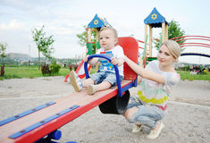 Mom and baby son play in the playground Stock Images