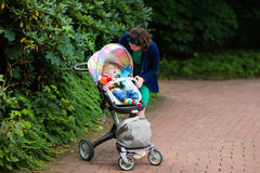 Mom and baby in a stroller Royalty Free Stock Photo