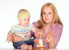 Mom with baby at table Royalty Free Stock Image
