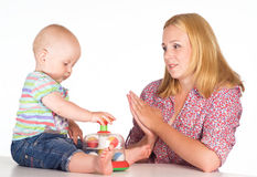 Mom and baby at table Royalty Free Stock Photography