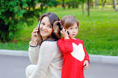 Mom with baby talking on phone Royalty Free Stock Photography