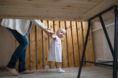 Mom and Baby Toddler girl first steps, lifestyle real interior, Royalty Free Stock Photography