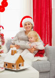 Mom and baby using tablet PC near Christmas tree Royalty Free Stock Photography