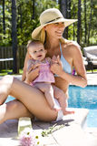 Mom and baby vacation Stock Images
