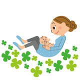 Mom and baby. Mom and the baby who are happy in a clover field Stock Images