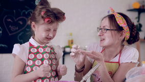 Mom baking with daughter in kitchen. stock footage
