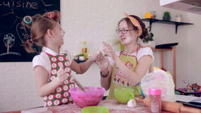Mom baking with daughter in kitchen. stock video footage