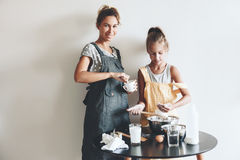 Mom baking with her daughter Stock Images