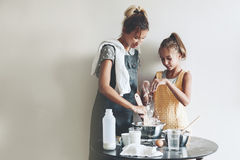 Mom baking with her daughter Royalty Free Stock Image