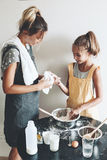 Mom baking with her daughter Royalty Free Stock Photo